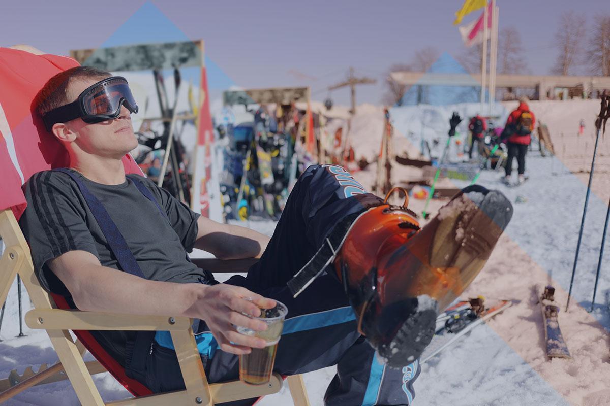 male skier drinks beer